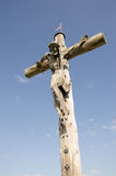 Jesus Christ at a wooden cross Stock Image
