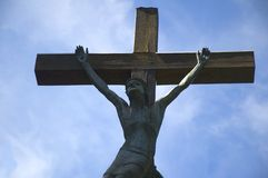 Jesus on the cross. Closeup of Jesus on the cross. On a blue background royalty free stock images
