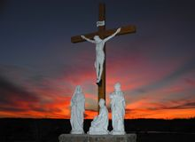 Jesus on the cross. Crucifixion scene in front of colorfull sunset Royalty Free Stock Images