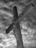 Jesus on the cross. Against dramatic sky Royalty Free Stock Photo