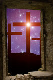 Cross Easter Stars. Jesus` cross on the Calvary hill with sky filled by twinkling sparkling stars as a  symbol of Christianity end Easter concept wisible through Royalty Free Stock Photos
