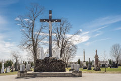 Jesus on the cross in a cimetery Stock Images