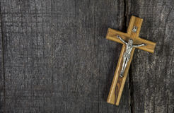 Jesus on cross: decoration on wooden background. Idea for a cond Royalty Free Stock Images