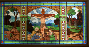 Jesus on the cross. Detail of victorian stained glass church window in Fringford depicting Jesus nailed to the cross Royalty Free Stock Image