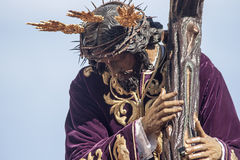 Jesus with the cross, Holy Week in Seville, brotherhood of San Roque Royalty Free Stock Photo