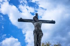 Jesus On The Cross. Christianity symbol with blue sky and clouds Stock Image