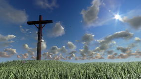 Jesus on Cross, meadow and timelapse clouds, stock footage Stock Photos