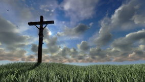 Jesus on Cross, meadow and timelapse sunset, stock footage Royalty Free Stock Photos