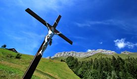 Jesus on the cross in the mountain Stock Images