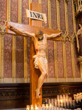 Jesus on cross and prayer candles Stock Image