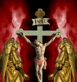 Jesus Christ INRI. Jesus on the cross with sign INRI above his head with angels on both side Royalty Free Stock Images