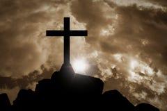 Cross silhouette with orange sky. Jesus cross silhouette with orange sky and sunlight Royalty Free Stock Image
