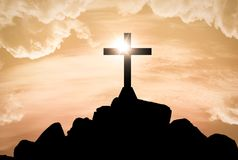 Jesus cross silhouette over sunset royalty free stock photos
