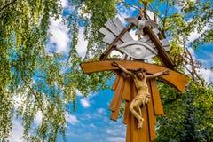 Jesus on cross. Summer outdoors sky and tree Stock Photos