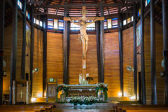 Jesus on cross in the wooden church Stock Image