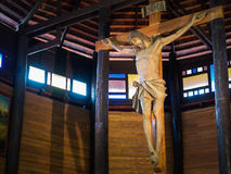 Jesus on cross in the wooden church Royalty Free Stock Photos