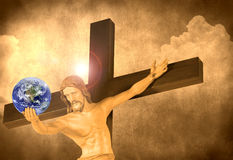 Jesus on the cross with the world in his hands. Jesus on the cross with a halo and the world in his hand with a cloud and stone background. Earth photo courtesy Royalty Free Stock Photography