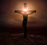 Jesus and crown. Jesus hanging on the cross with a glowing crown royalty free stock images