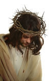 Jesus With Crown of Thorns. Portrait of Jesus with crown of thorns isolated over white background Stock Photo