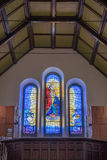Jesus crowns Mary in stained glass window, Galway, Ireland. Galway, Ireland - August 5, 2017: Stained glass window above main entrance to St. Mary's Dominican Stock Photos