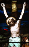 Jesus crucified. A stained glass photo of a crucified Jesus royalty free stock photography