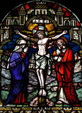 Jesus crucified. A stained glass photo of a crucified Jesus stock photos