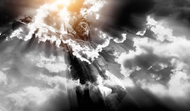 Jesus crucified. Wooden Jesus crucified with clouds and sun background Stock Photos