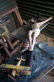 Jesus on crucifix in thrift store Stock Photo