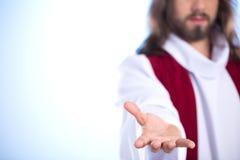 Jesus, der heraus seine Hand erreicht stockfoto