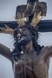 Jesus die op de dwars, Heilige Week in Sevilla sterven, het Broederschap van het Puppy Royalty-vrije Stock Afbeelding