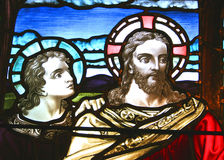 Jesus & the Disciple. Stained glass pictorial of Jesus and a disciple Stock Images