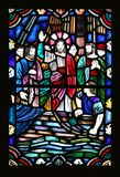 Jesus and the Disciples. An old stained glass window featuring Jesus and the disciples in what looks to be a boat on water Royalty Free Stock Photography