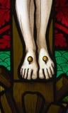 Jesus Füße auf dem Kreuz stockbild