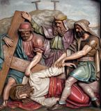 Jesus falls the third time, 9th Stations of the Cross. The parish church of St. Peter and Paul in Oberstaufen, Germany Royalty Free Stock Image