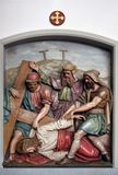 Jesus falls the third time, 9th Stations of the Cross. The parish church of St. Peter and Paul in Oberstaufen, Germany Stock Photo