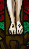 Jesus' feet on the cross. Detail of victorian stained glass church window in Fringford depicting Jesus' feet nailed to the cross stock image