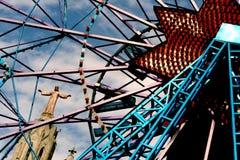 Jesus on a ferry wheel. A statue of Jesus near a ferry wheel in barcelona Royalty Free Stock Photo