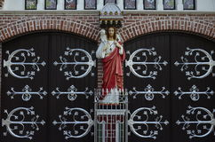 The Jesus figure in front of Gate to St. Mary`s Cathedral, Yangon Stock Photo