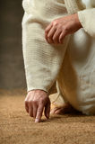 Jesus Finger Writing in the Sand Stock Photography