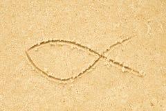 Jesus fish symbol drawing in sand Royalty Free Stock Photos