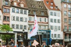 Jesus flagga med huset i bakgrund på mars för Jesus Royaltyfri Fotografi