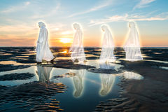 Jesus Followers. Jesus Christ with three others following him at sunset Royalty Free Stock Photos