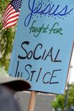 Jesus Fought for Social Justice. Protest Sign at the 2017 Women`s March in San Diego stock image