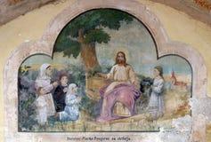 Jesus friend of the little children. Fresco in the Church of Saint Saint Michael in Vugrovec, Croatia Stock Images