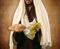 Jesus gives bread and grapes stock photos