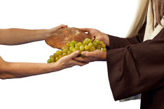 Jesus gives bread and grapes royalty free stock image
