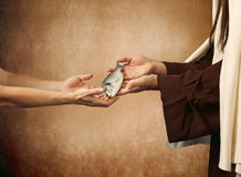 Jesus gives the fish to a beggar royalty free stock images