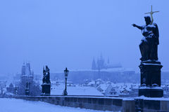 Jesus with golden cross on Prague Charles Bridge, during snawfall Stock Photography