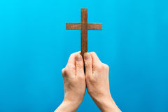 Jesus hand and cross. On blue background Stock Images