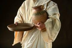 Jesus Hands Holding Jar y cacerola Imágenes de archivo libres de regalías